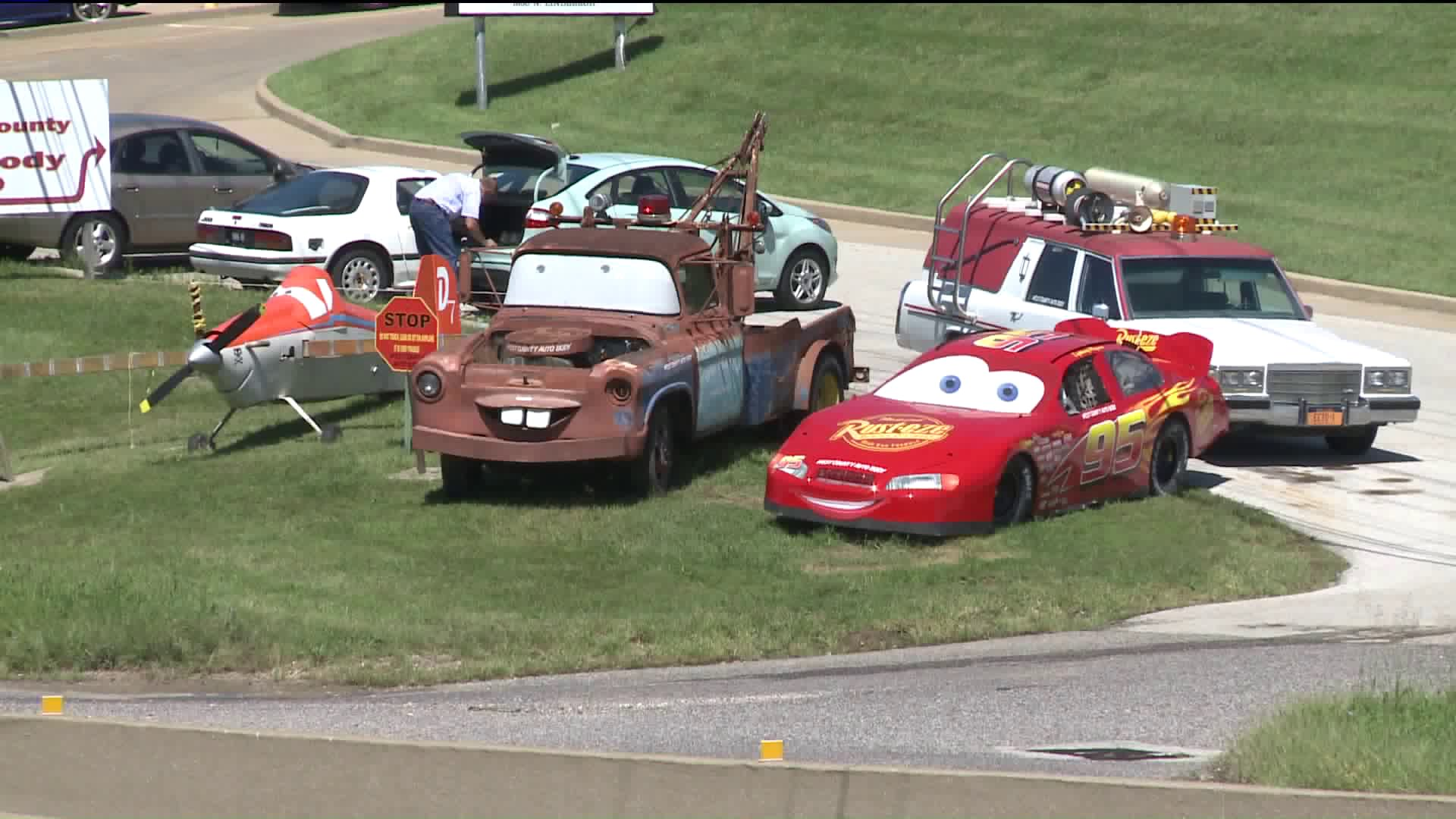 Local Auto Body Shop Draws Child Excitement With Cars Characters